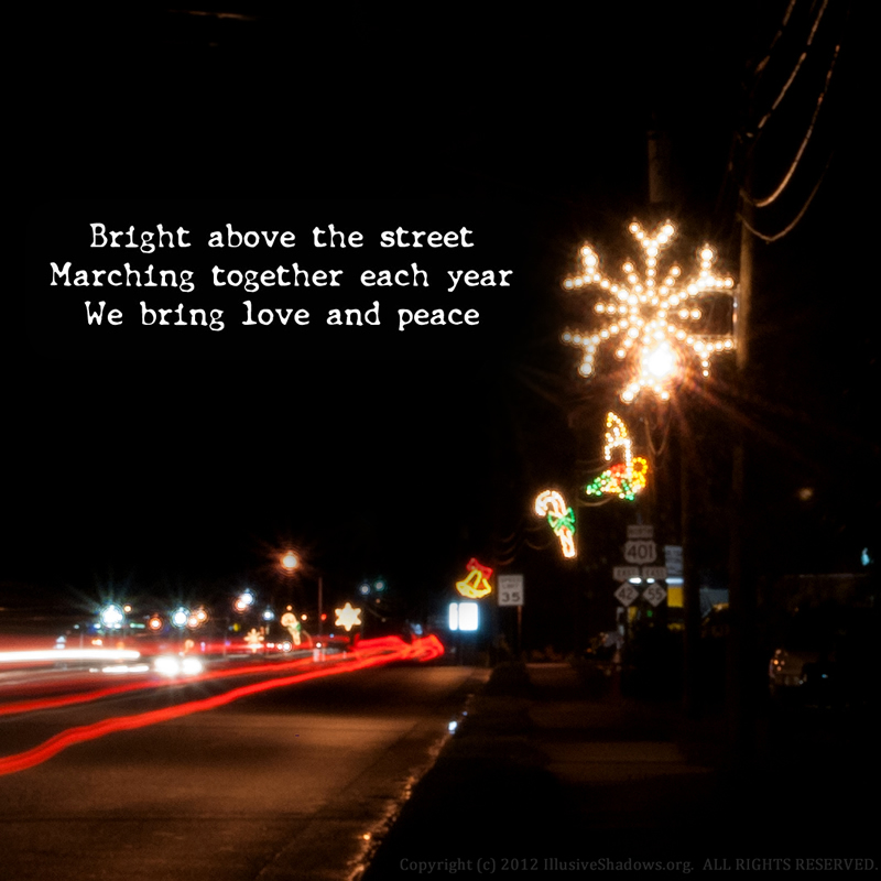 Bright above the street; Marching together each year; We bring love and peace.